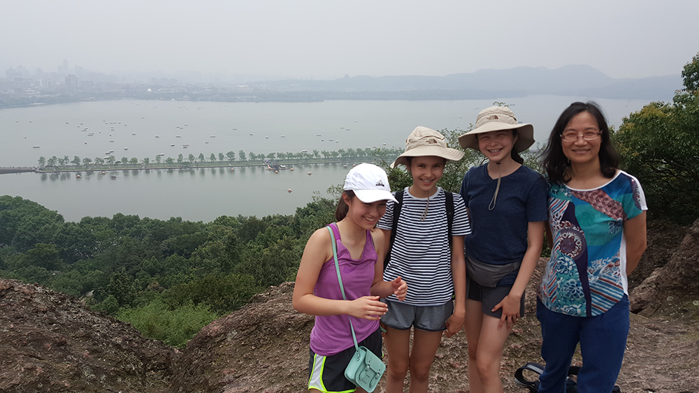 Xiaowen and our students at the top of Bao Shi Shan overlooking China's famous West Lake.
