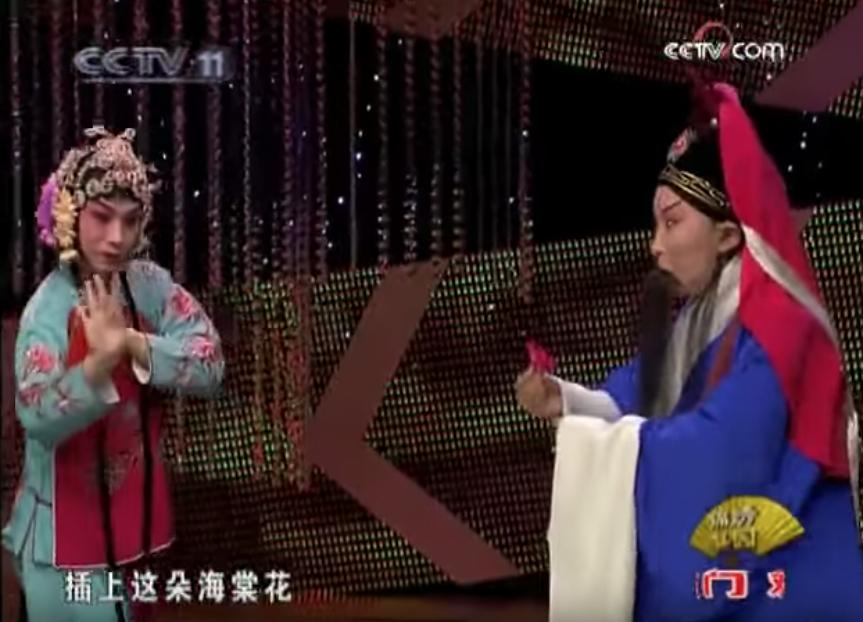 """A scene from the famous Peking Opera """"The Wandering Dragon Tricks The Phoenix,"""" featuring Peipei Jiang and Zheng Liu."""