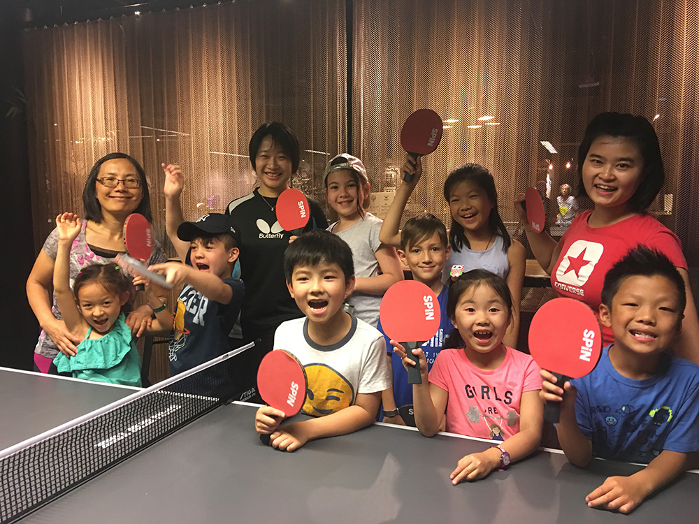 Our campers with their teachers and ping pong coach Taylor.