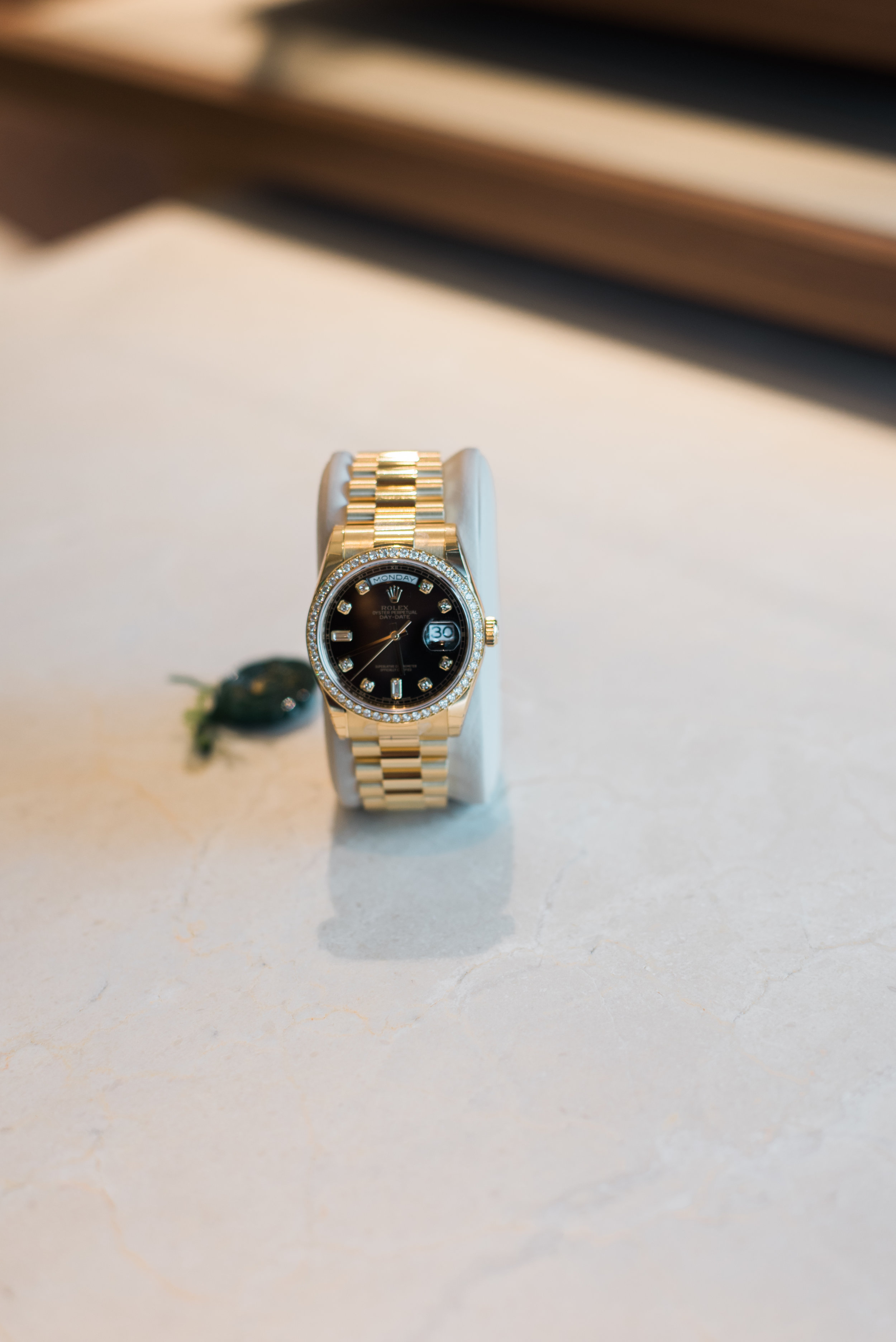 (Rolex 18K yellow gold Day Date with black diamond dial and full diamond bezel.)