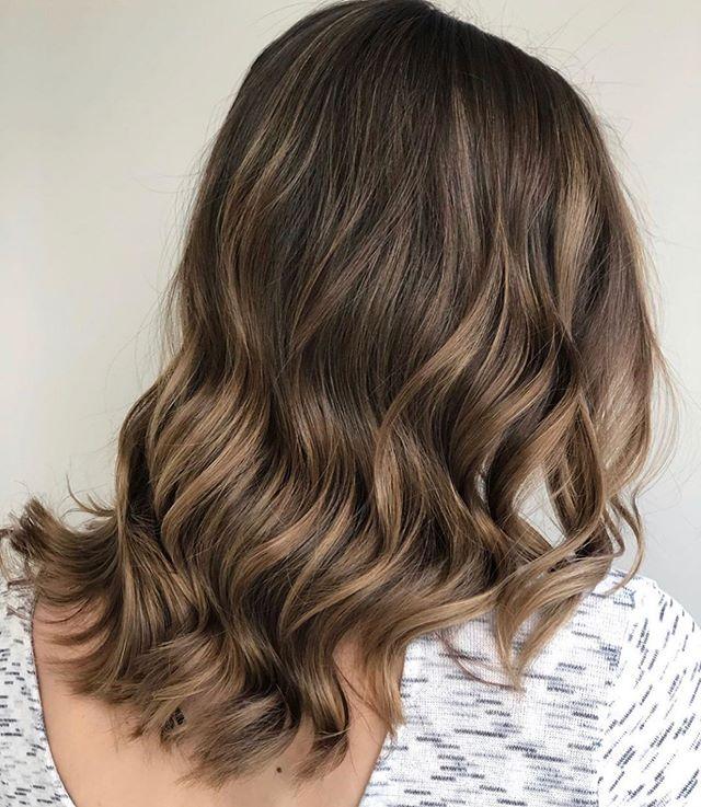 Gorgeous work from one of our talented stylists!  Healthy, shiny and sun kissed!  Beautiful work!! @hairbyashlynboyd . #hairandbodysalonsuites #eastlansingsalon #michiganstylist #lovewhatwedo #lovelansing #eastlansinghair #healthyhair #brunette #waves #nofilterneeded