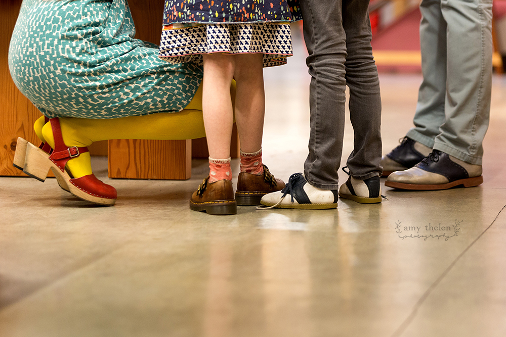 colorful shoes on family of four