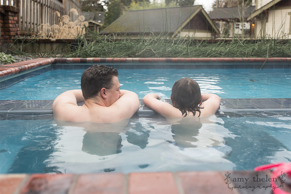 dad and son in hot tub