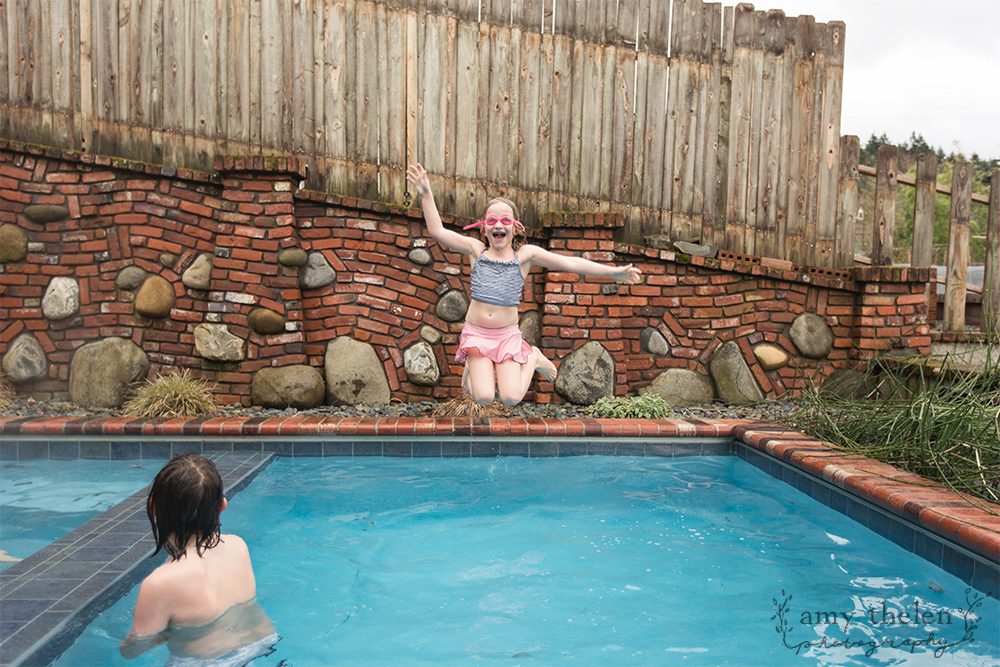 girl with goggles jumping