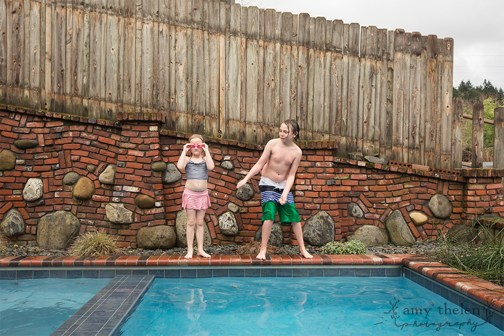 girl and boy dancing near pool
