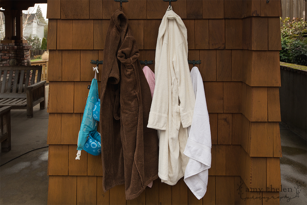 family's robes and towels after pool