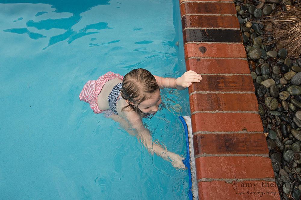 girl scrubbing pool edge