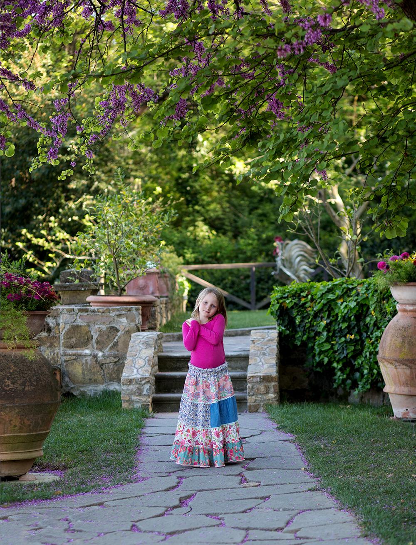 girl standing in garden tuscany