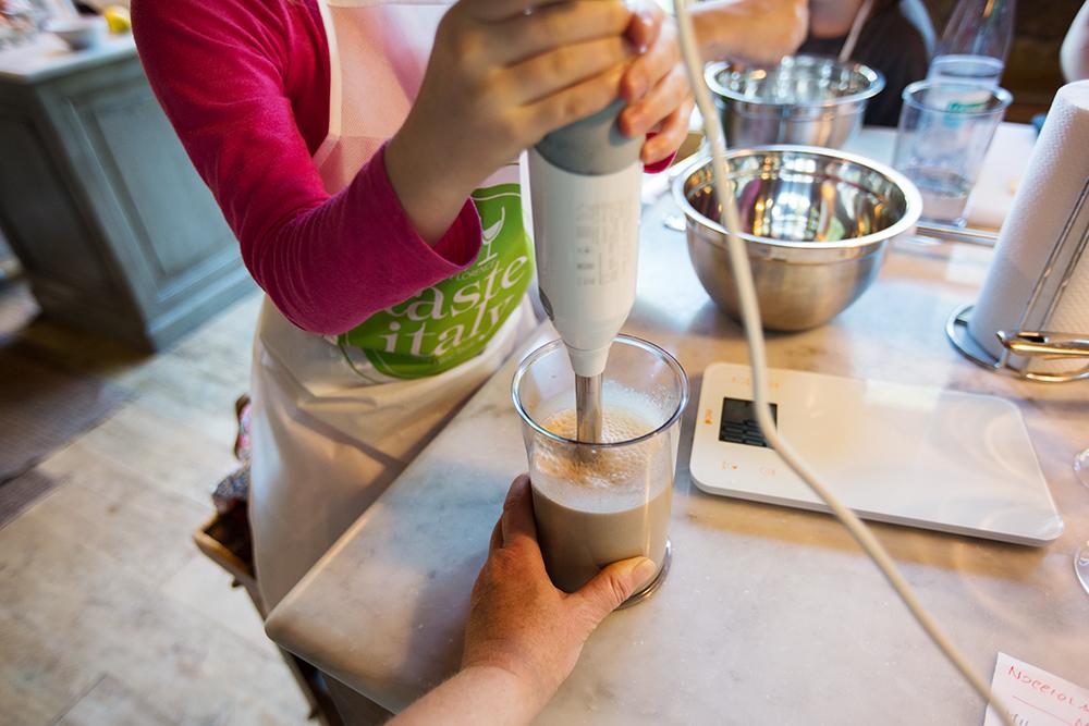 girl using immersion blender