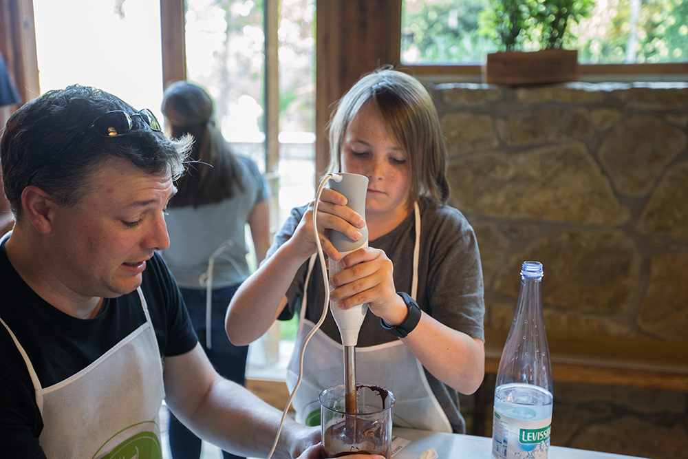 dad surprised as son uses immersion blender