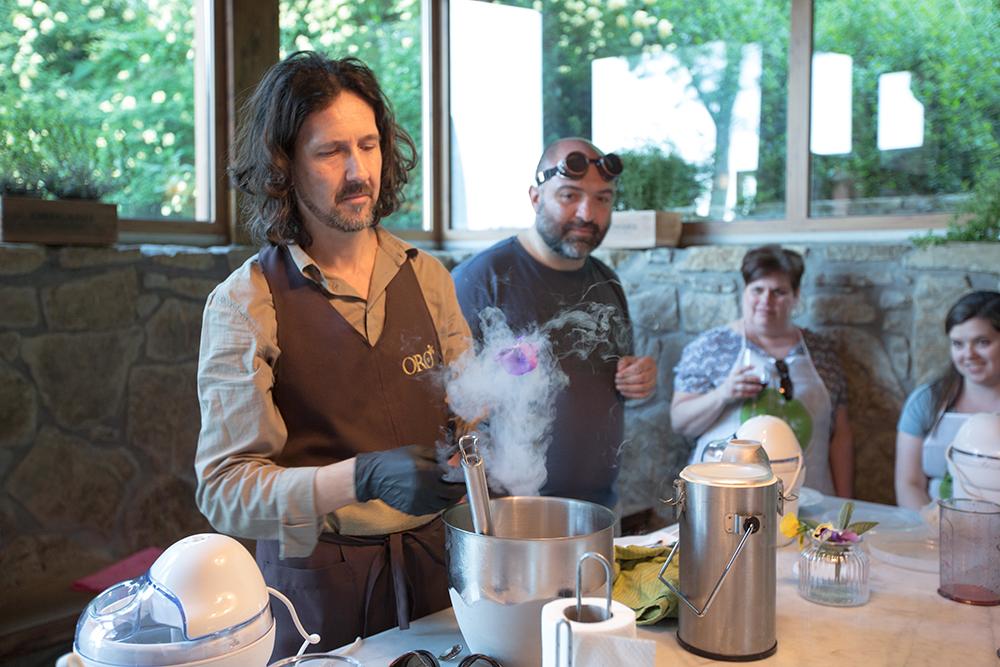 teacher pouring liquid nitrogen into bowl
