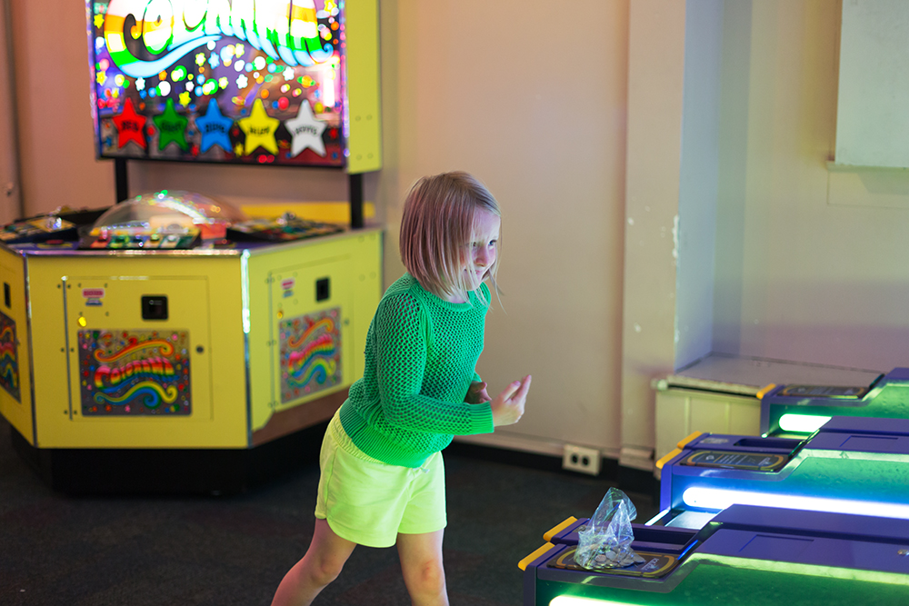 girl playing skeeball