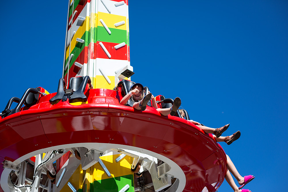 girl with thumbs up on free fall ride