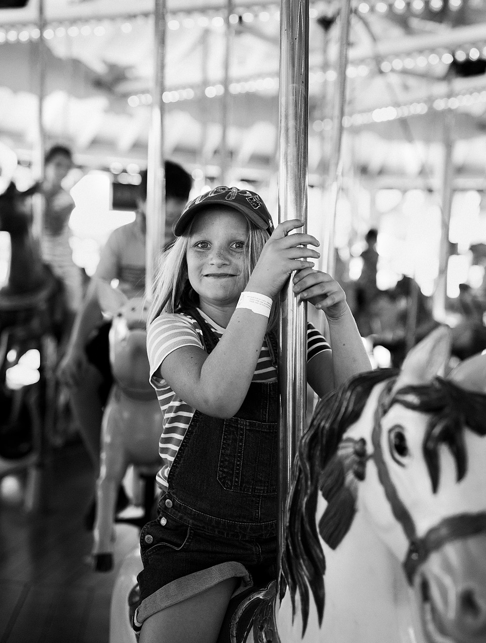 girl on carousel in black and white