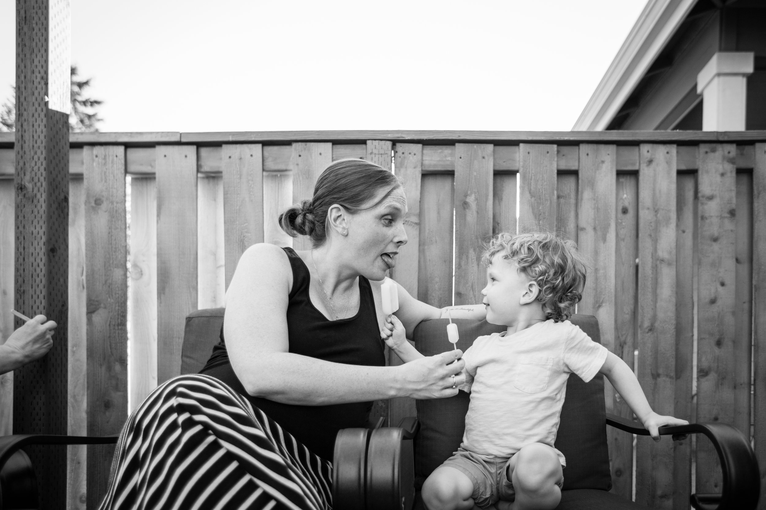 mom and boy sharing popsicles