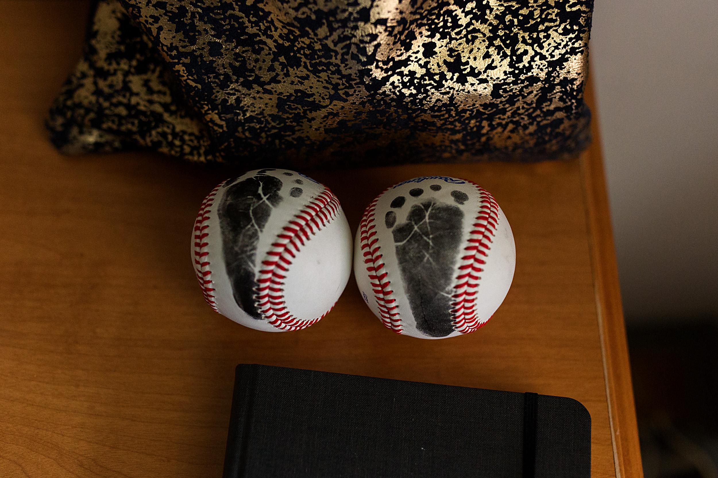 footprints on baseballs for each of dad's boys