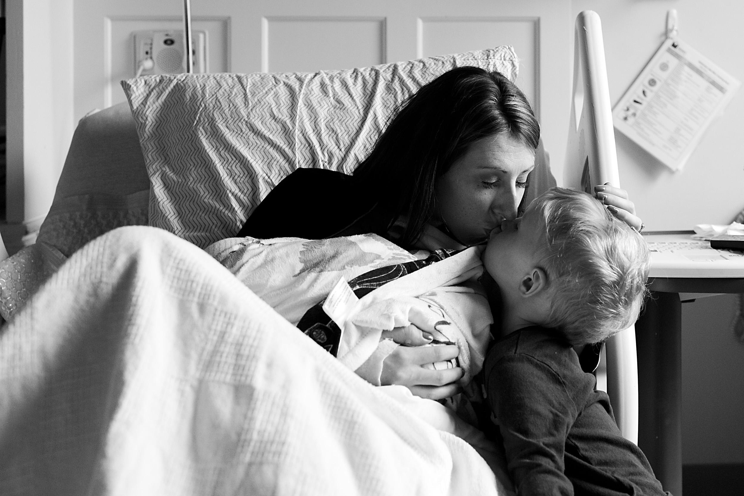 mom and son kiss goodbye