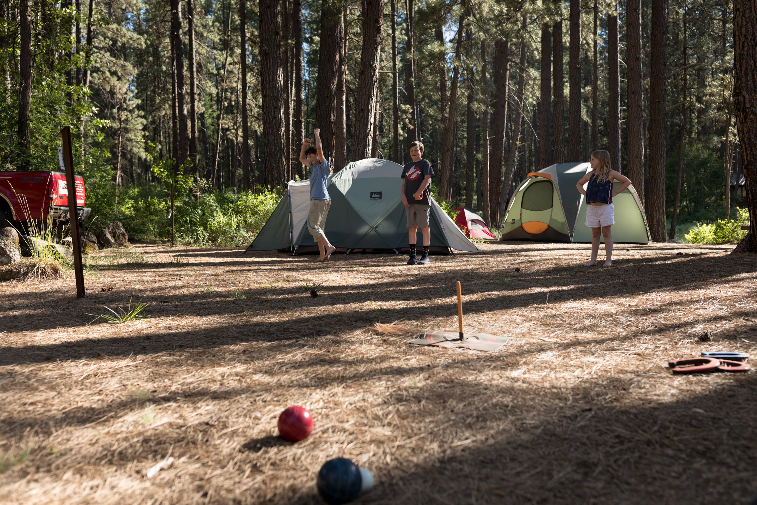 children playing bocce ball while camping