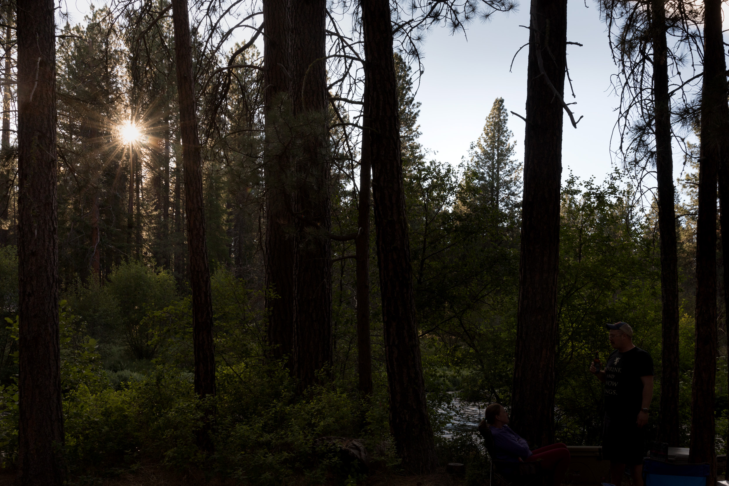 the sun sets over the Metolius River in Sisters, Oregon