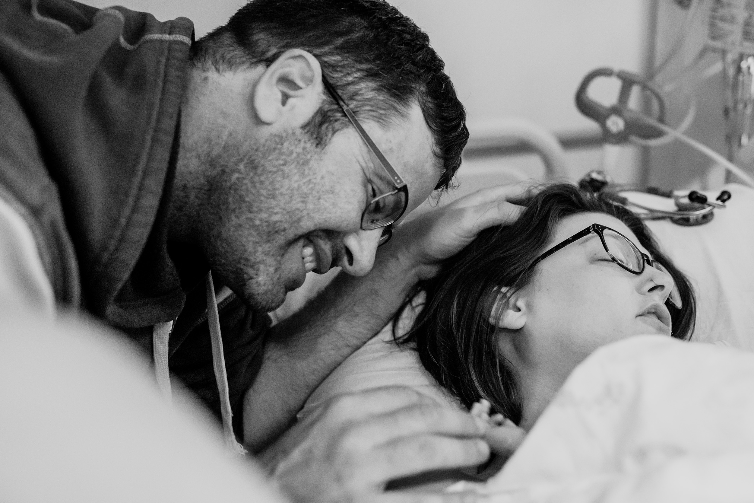 Dad holds onto daughter's tiny little fingers after birth
