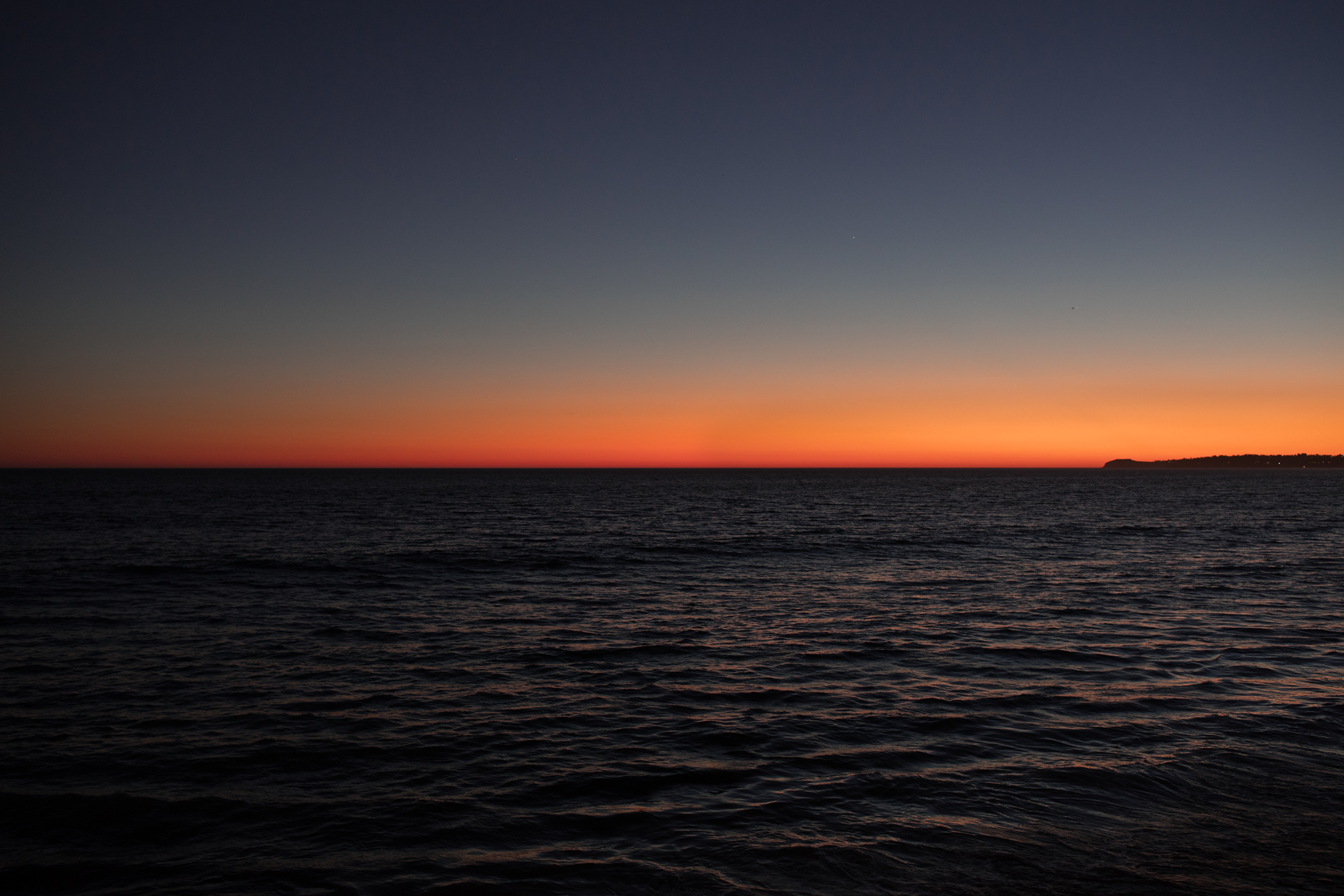 Final light of day as the sun sets over the Pacific Ocean in Malibu.