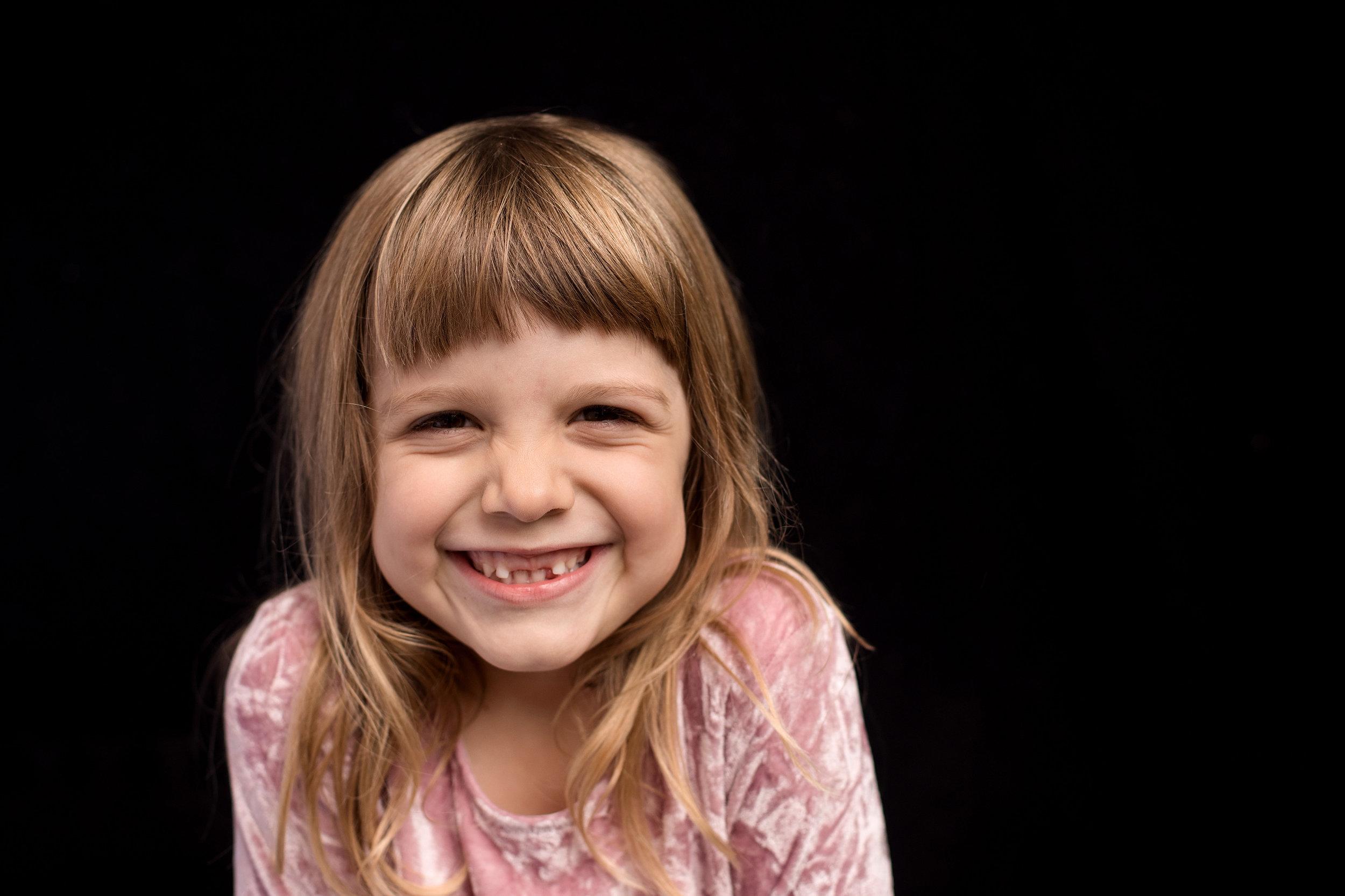 happy smiling girl during her modern school portrait