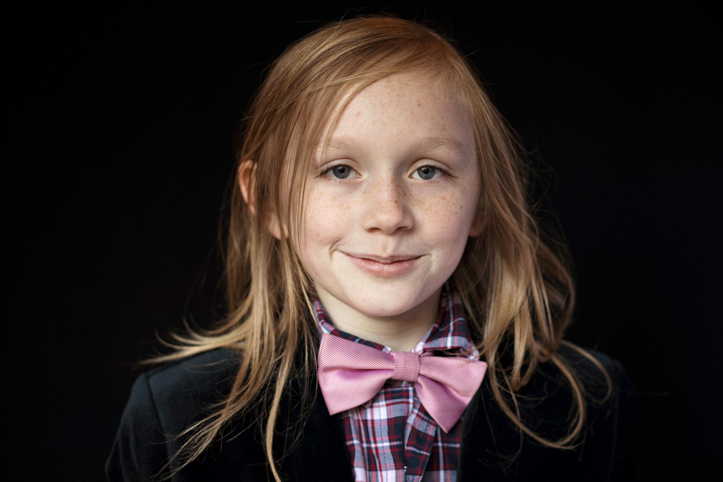 boy in tie with smirk grade school photo
