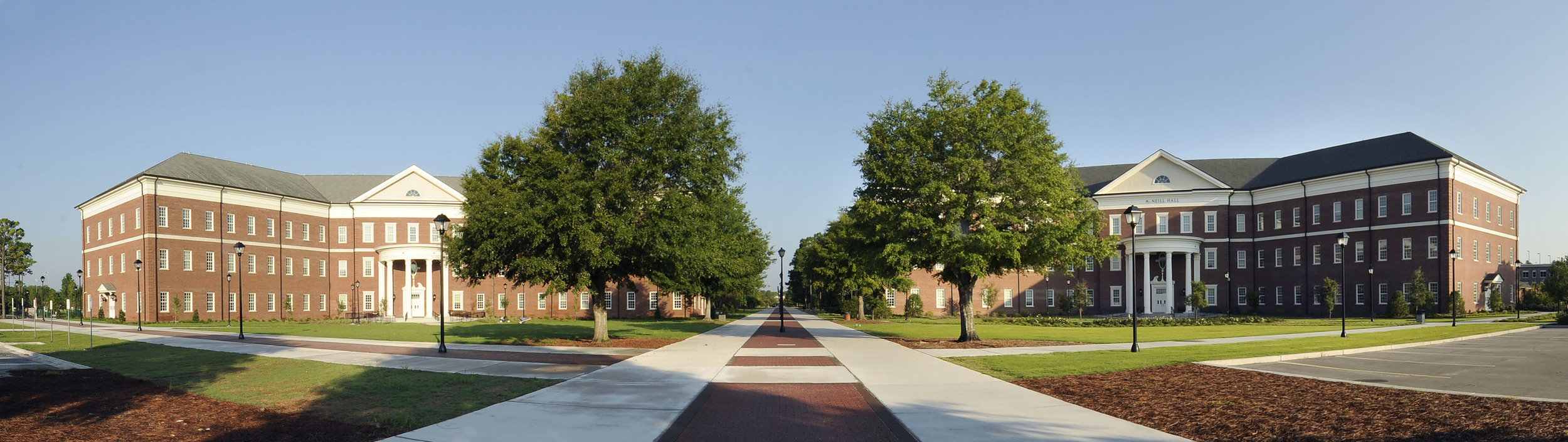 New Teaching Laboratory Building (left) and McNeill Hall, School of Nursing -Health Quad - UNC Wilmington campus - building exterior architecture.  Chancellor's Walk - UNCW / Jamie Moncrief