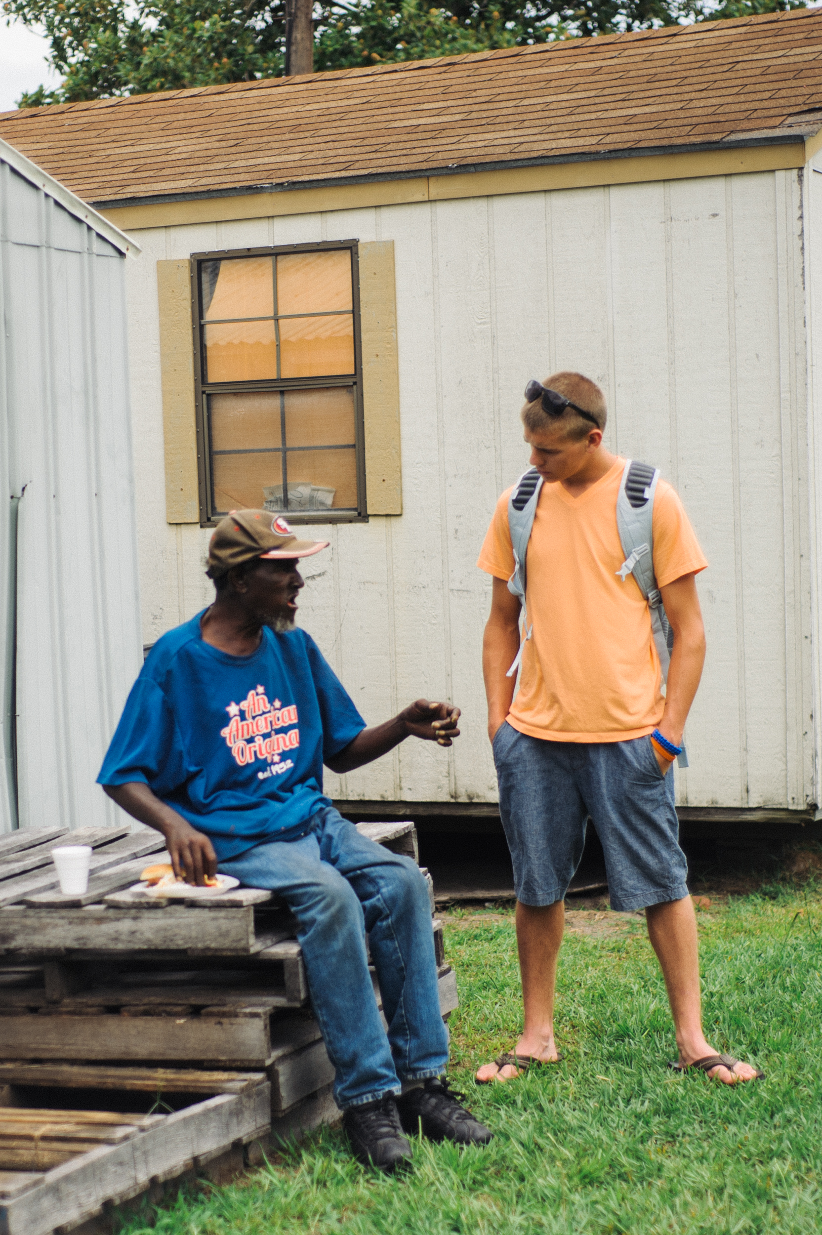 A Go Group Guide shares the Gospel after we host an inner city cookout.