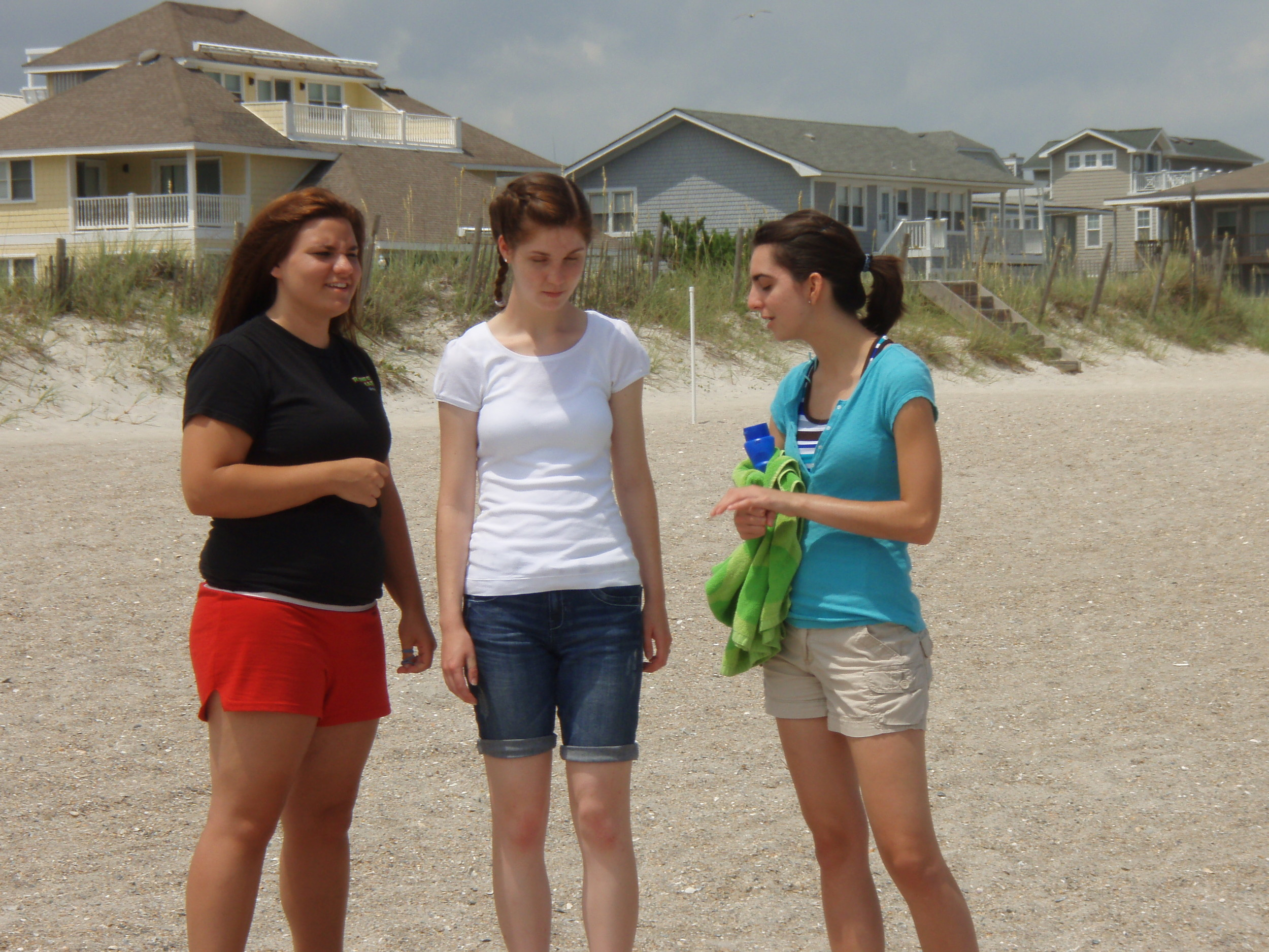 Some students are out sharing the Gospel of Christ on the beach.