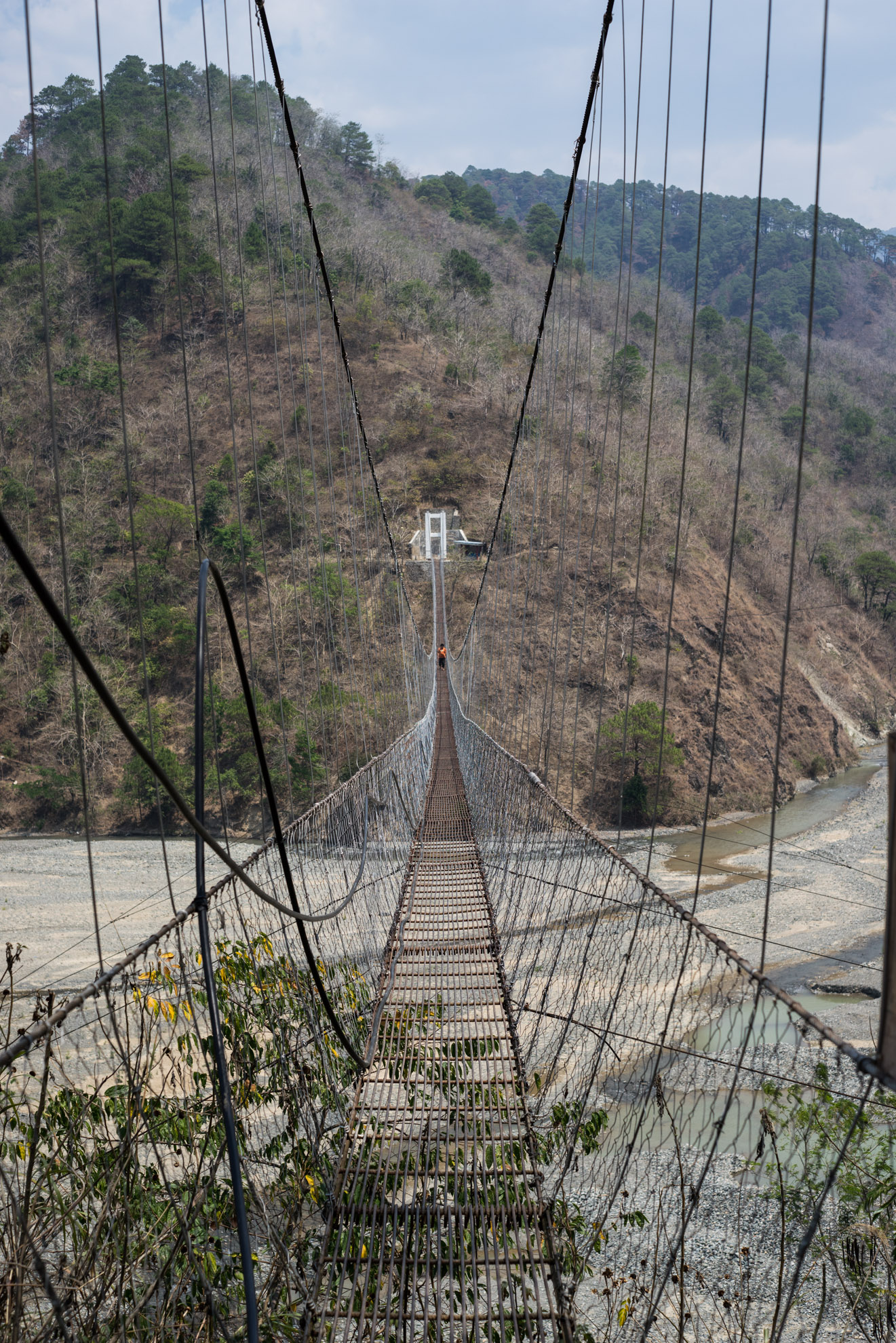 A cable bridge over a river in northern Philippines