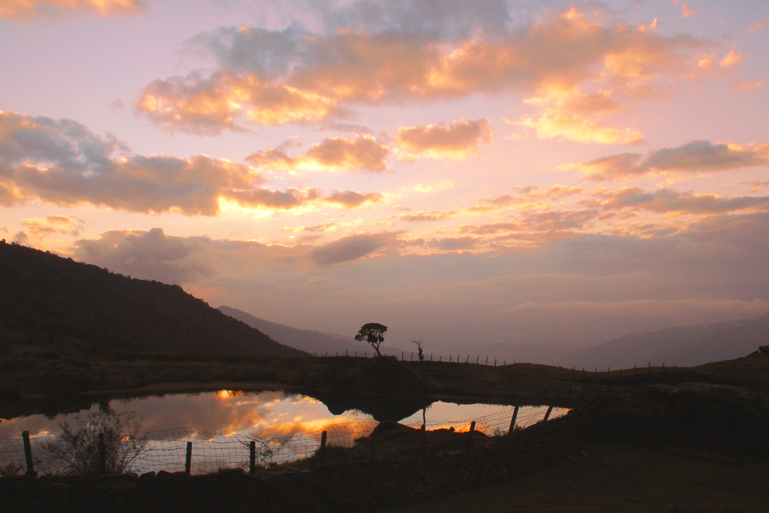 Nepal.EastNepal.GuphaPokhari.Sunset.Reflection.Clouds1.jpg