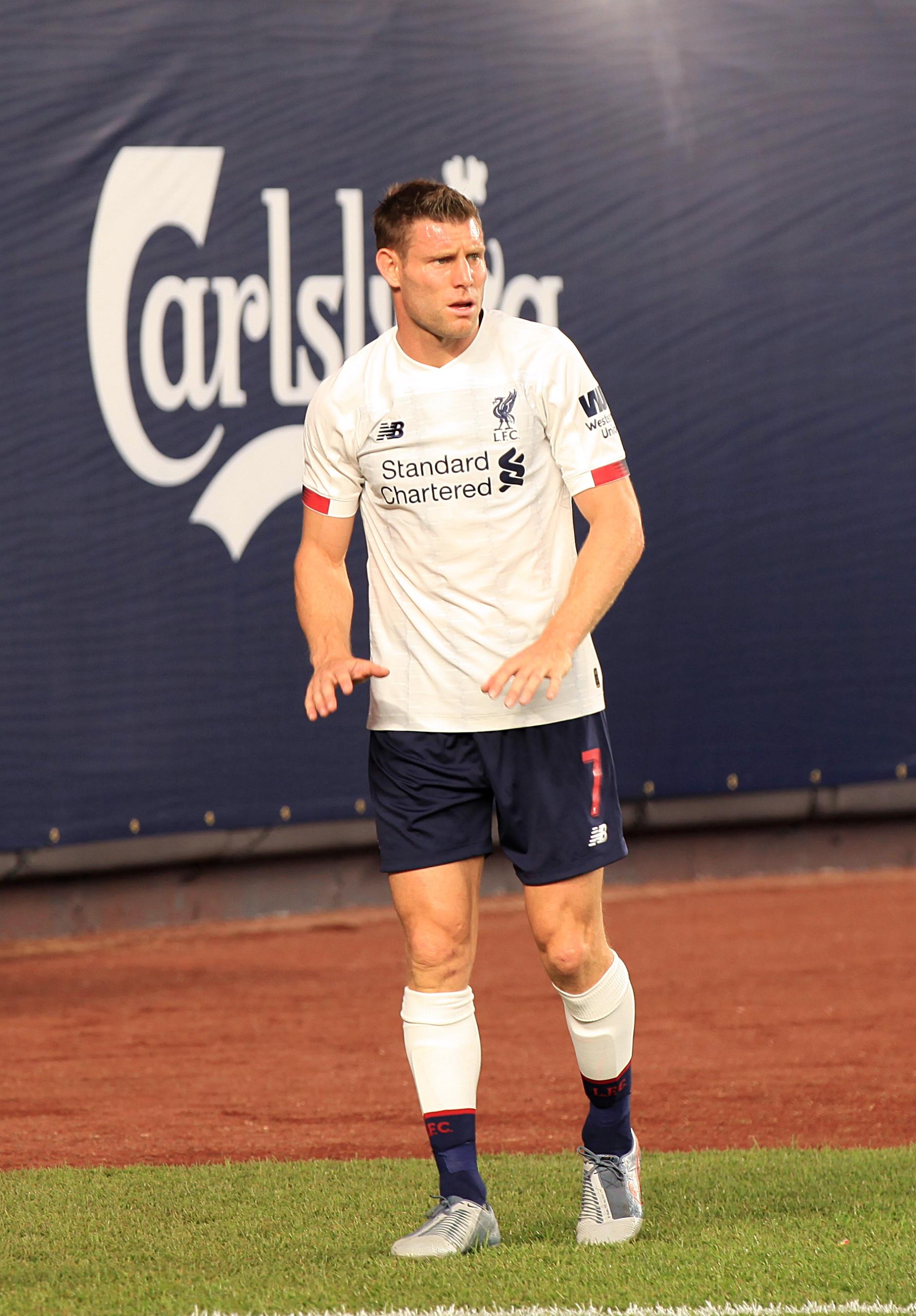 Milner takes a corner.