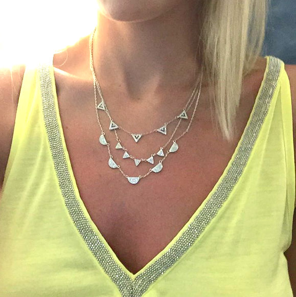 The Pavé Chevron Necklace in silver is all you need to master delicate layering.