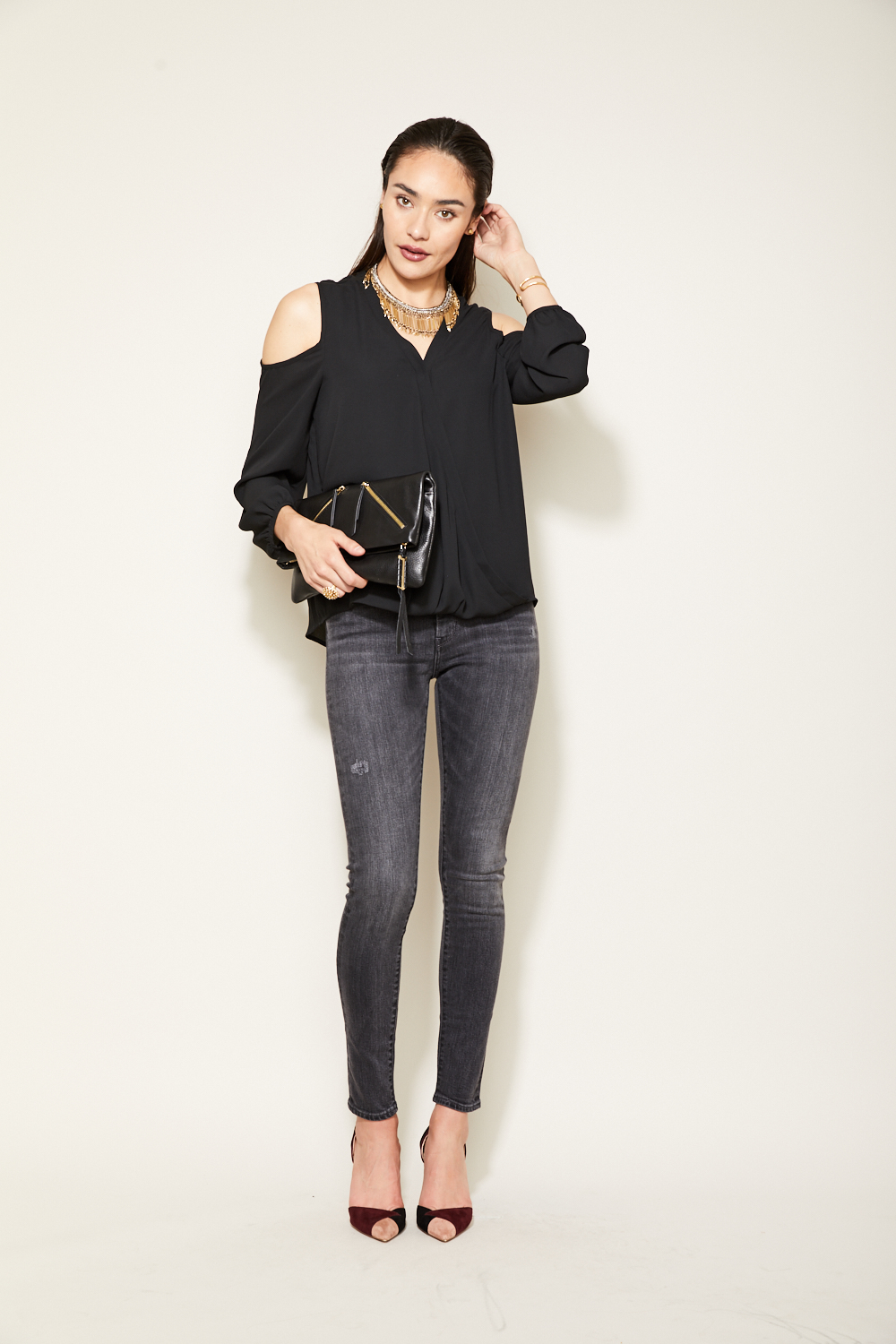 2. The Gray Skinny - We love grey jeans because they are an unexpected color that surprisingly goes with everything. Dress them up for a night on the town with our black Everett Cold Shoulder top, or relaxed with your favorite flats and leather jacket. They have just enough distressing to be causal, and not too crazy to be dressed up. #perfection