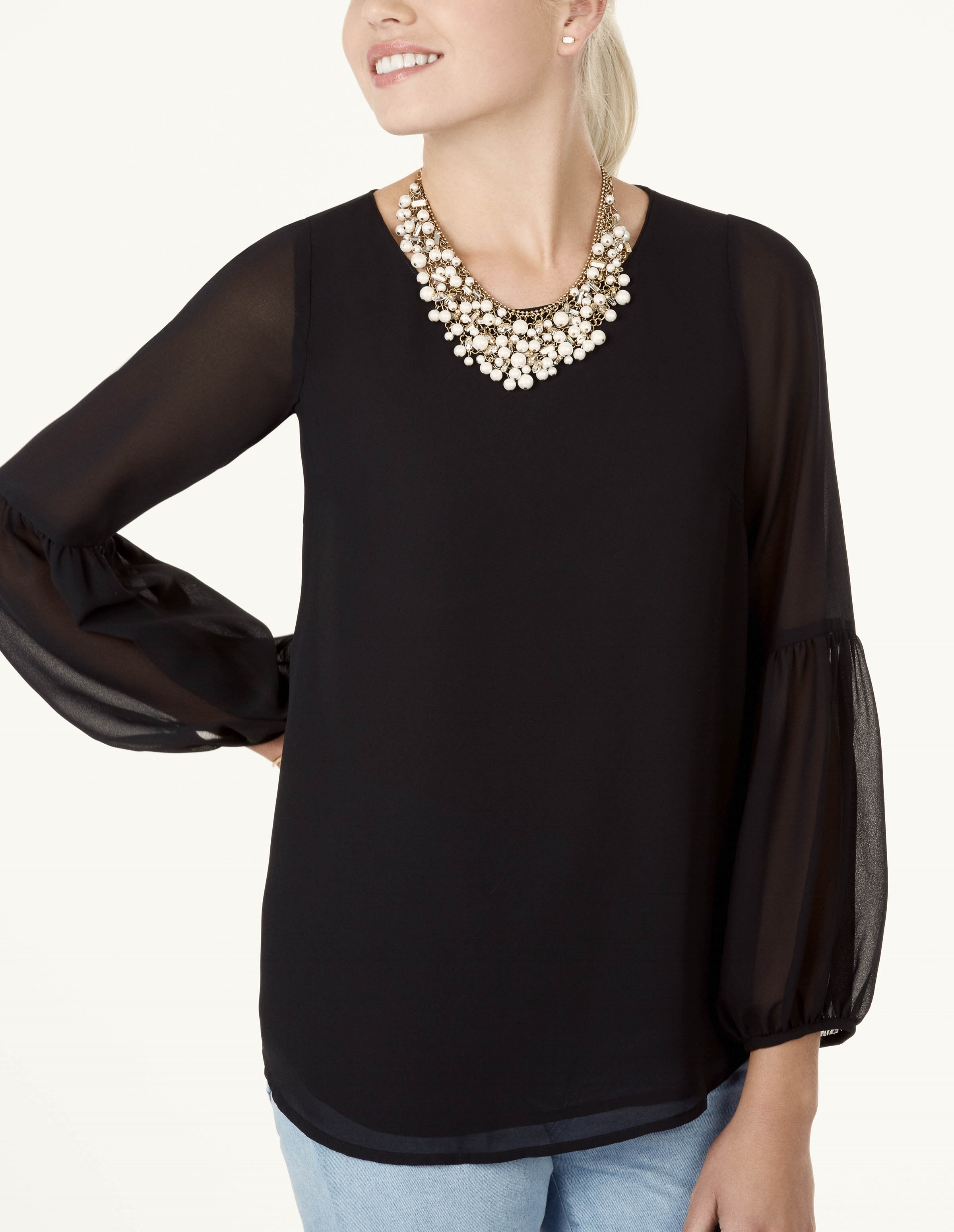 3. The Sophie Top - Remember the printed Sophie that made it's debut last month? Well this is her older sister. The Sophie in black is such a classic wardrobe staple because it's really like a blank canvas. You can wear just about any kind of accessory with it and you will always be on trend. Pair it with a statement necklace like pictured to the left for a bolder look, or pair it down with delicate layers. The slightly sheer sleeve is perfect for to day-to-night dressing.