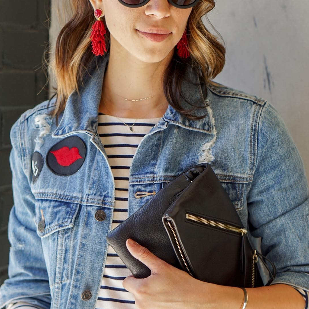 Friday - Embrace Casual Friday with a distressed denim jacket and add a pop of color with your favorite patches and statement earrings. These Riva Tassel earrings instantly make your outfit more playful and weekend-ready!