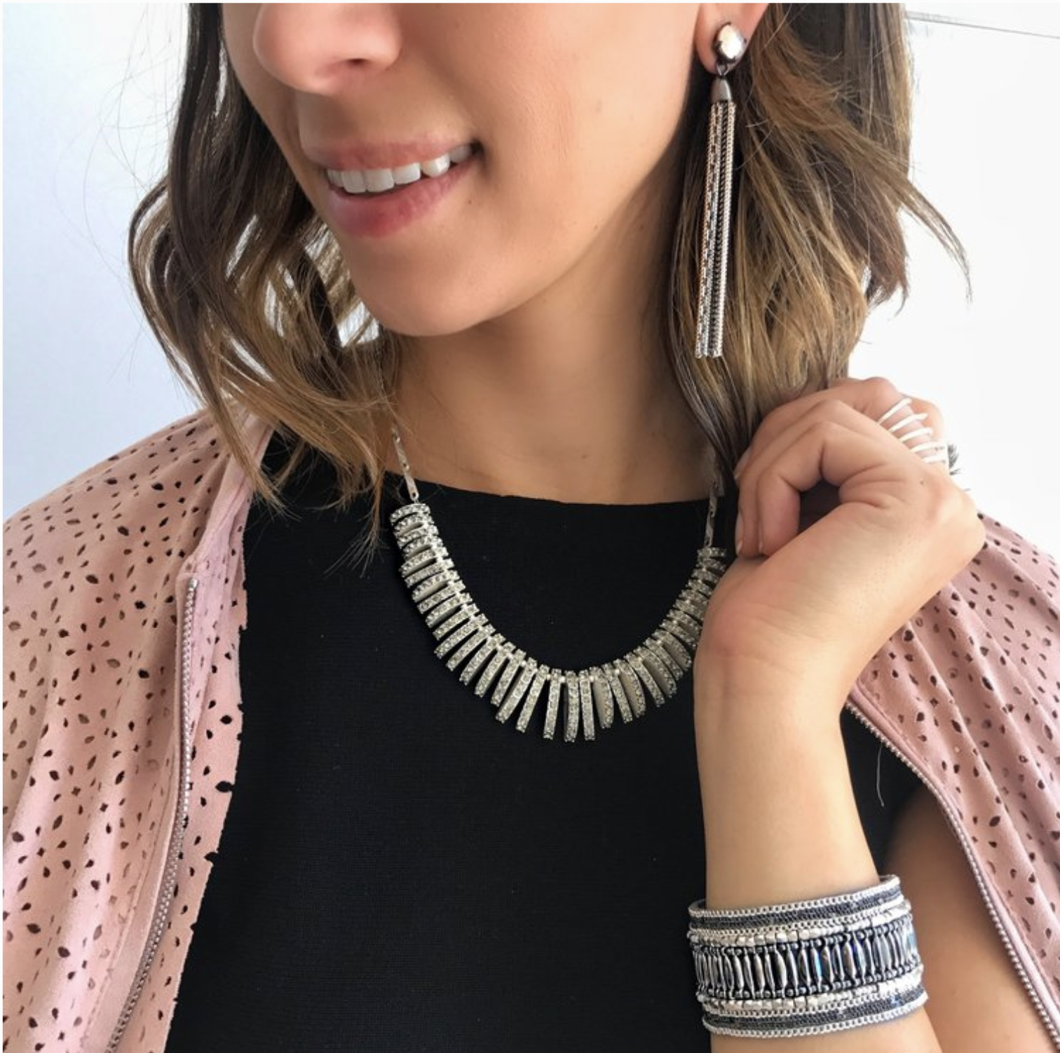 Thursday - You're officially working for the weekend and mixed metal accessories might not get you there faster (sorry!) but they'll be sure to impress in the meantime. Plus, these Fringe Tassel earrings also convert to a stud, for 2-looks-in-1!