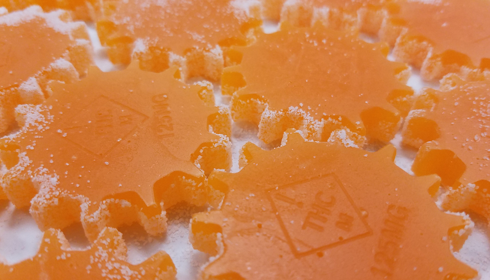 "A zoom shot of our new 125mg single serve gummy - Mango flavor pictured. (Gummy measures 2.00"" across)"