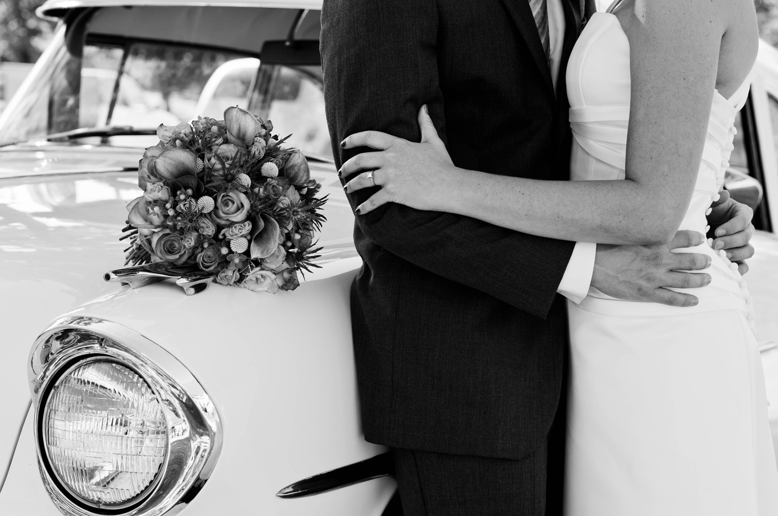 Bride and Groom with old car, black and white