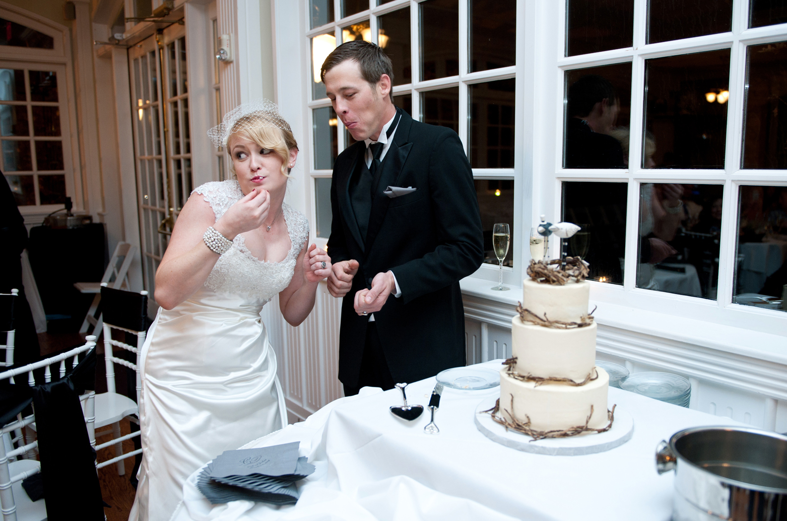 Bride and Groom sharing wedding cake
