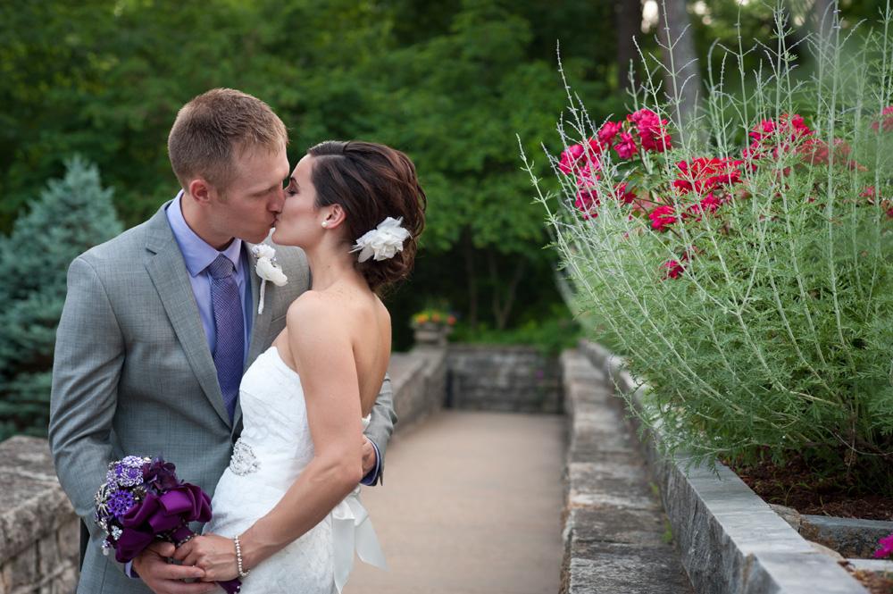 Bride and Groom kiss, St Elizabeth's Catholic Church Walkway