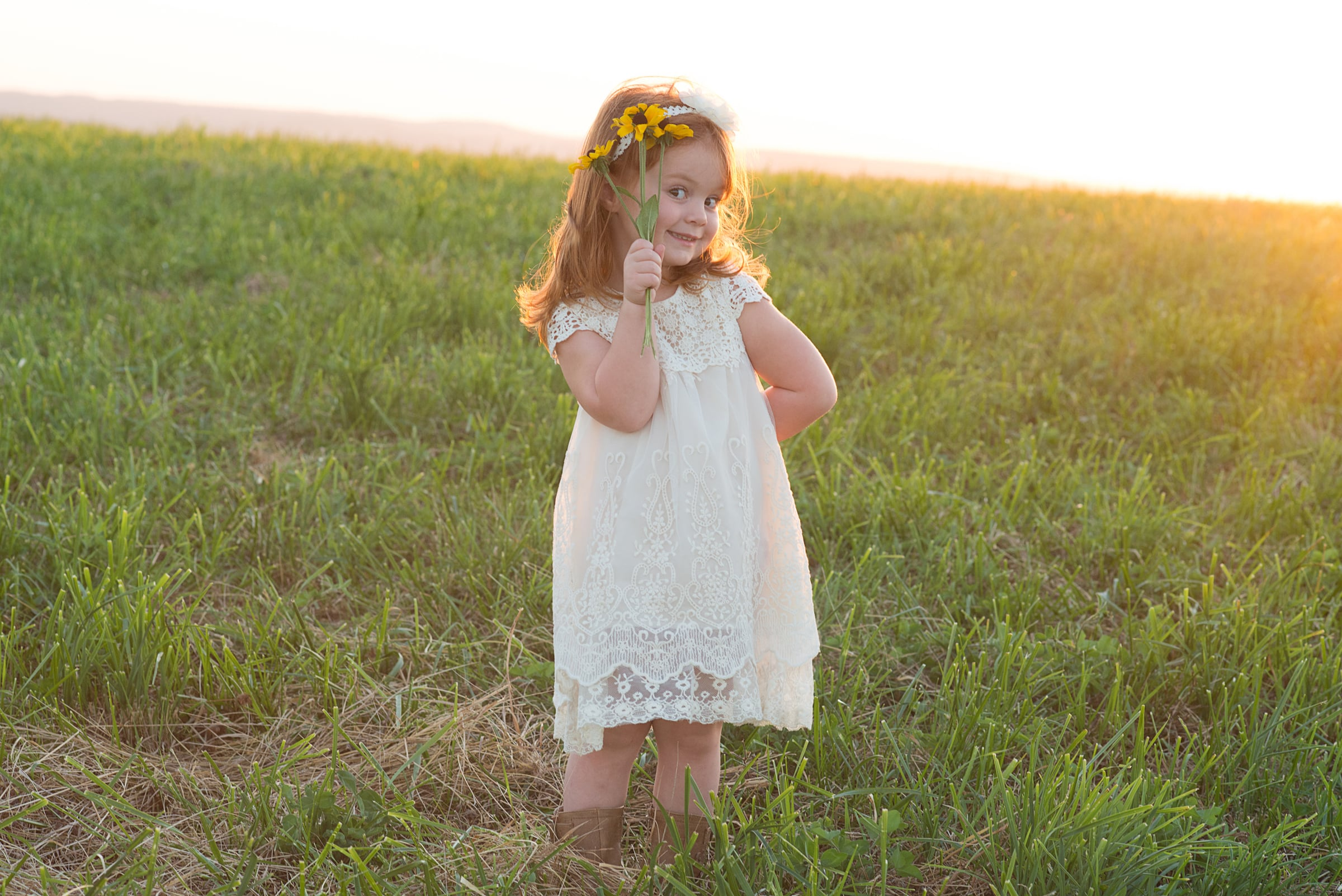 little girl at sunset in meadow