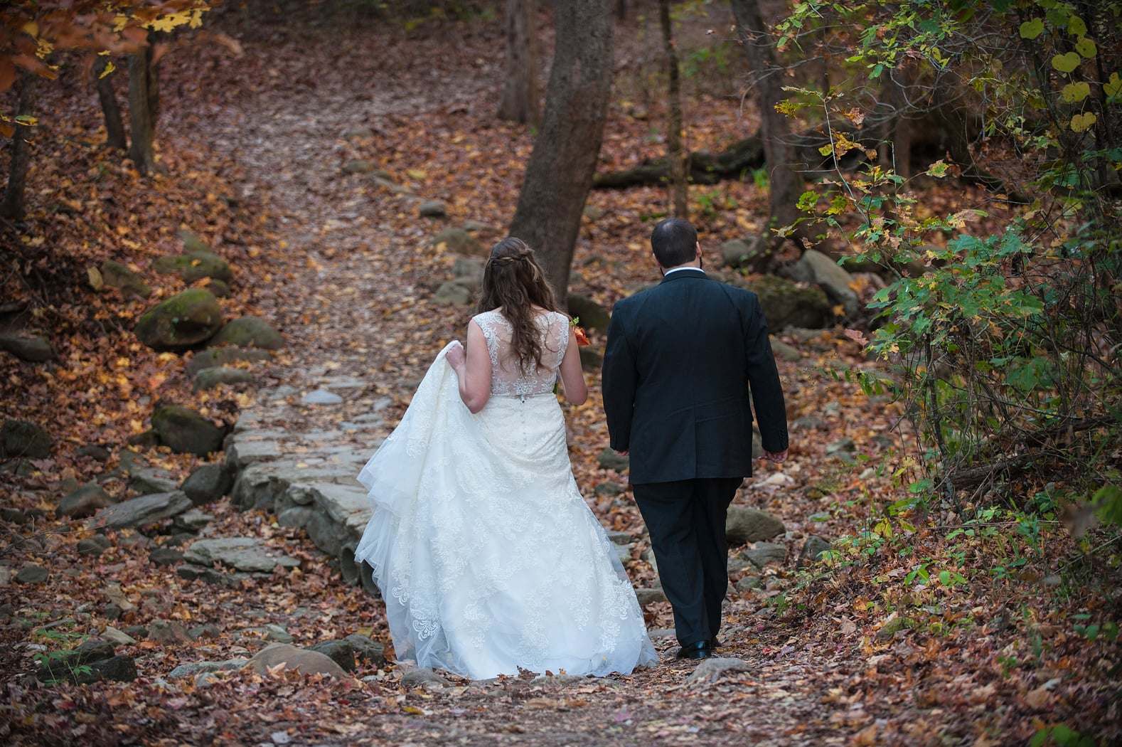 Bride and groom walking in Lost Valley