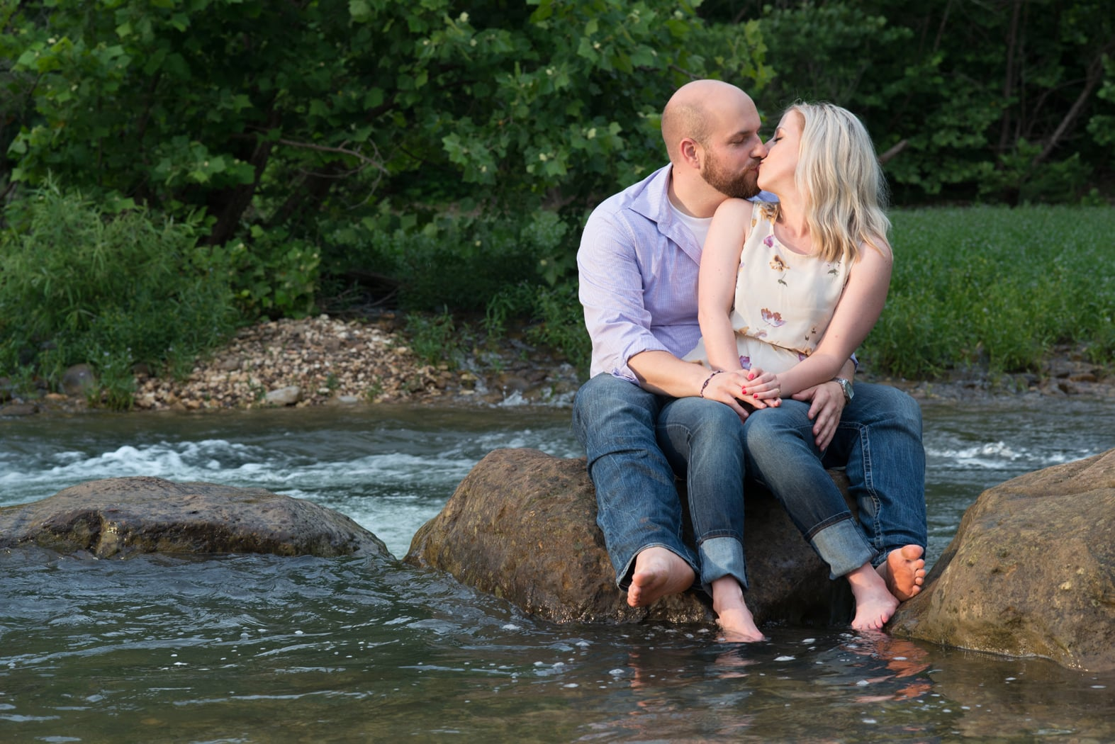 Couple kisses in Buffalo River