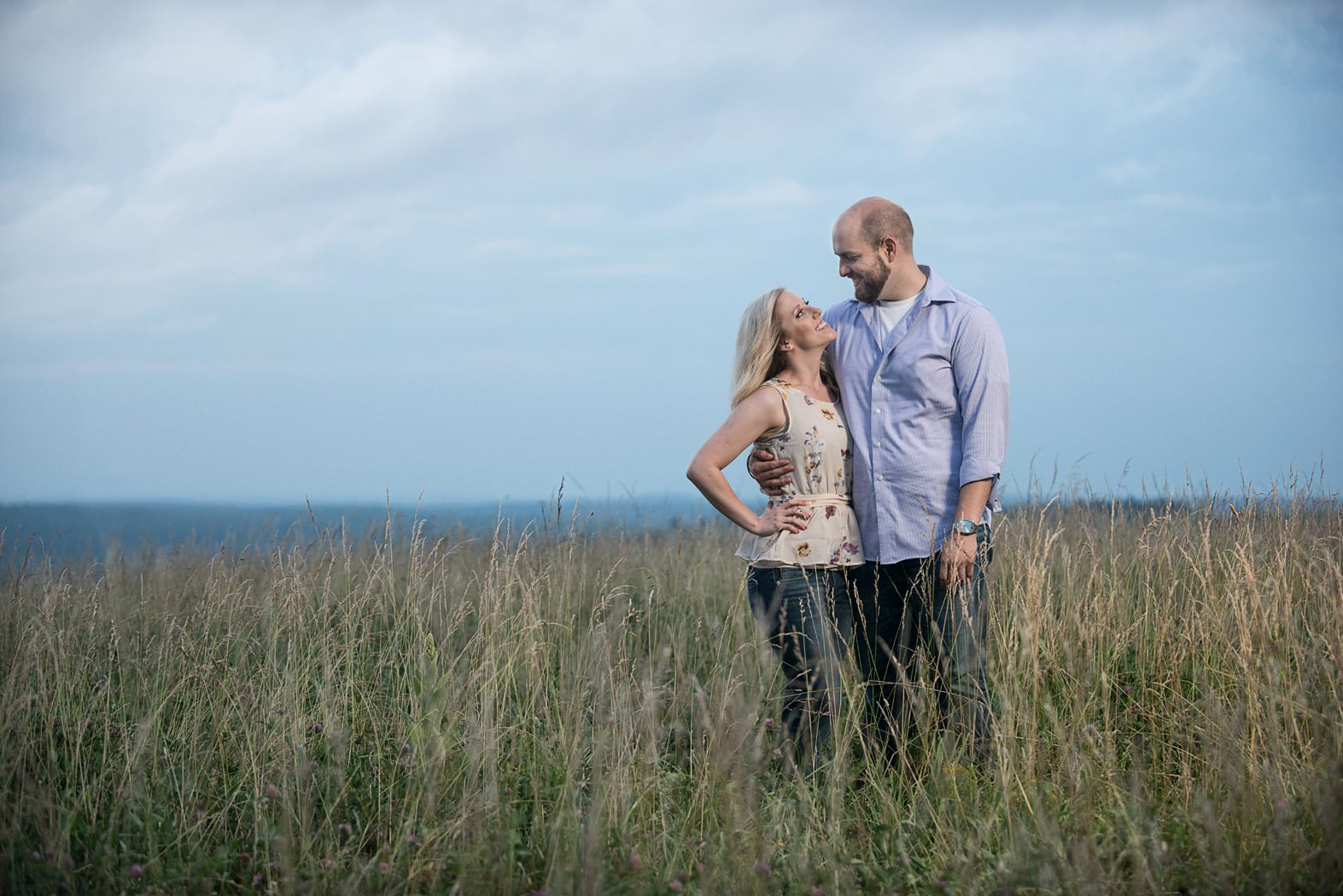 Couple in tall grass meadow