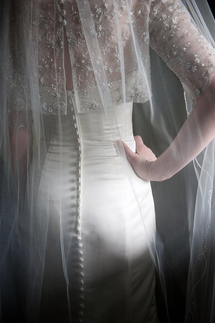 Bride dress back detail in window light