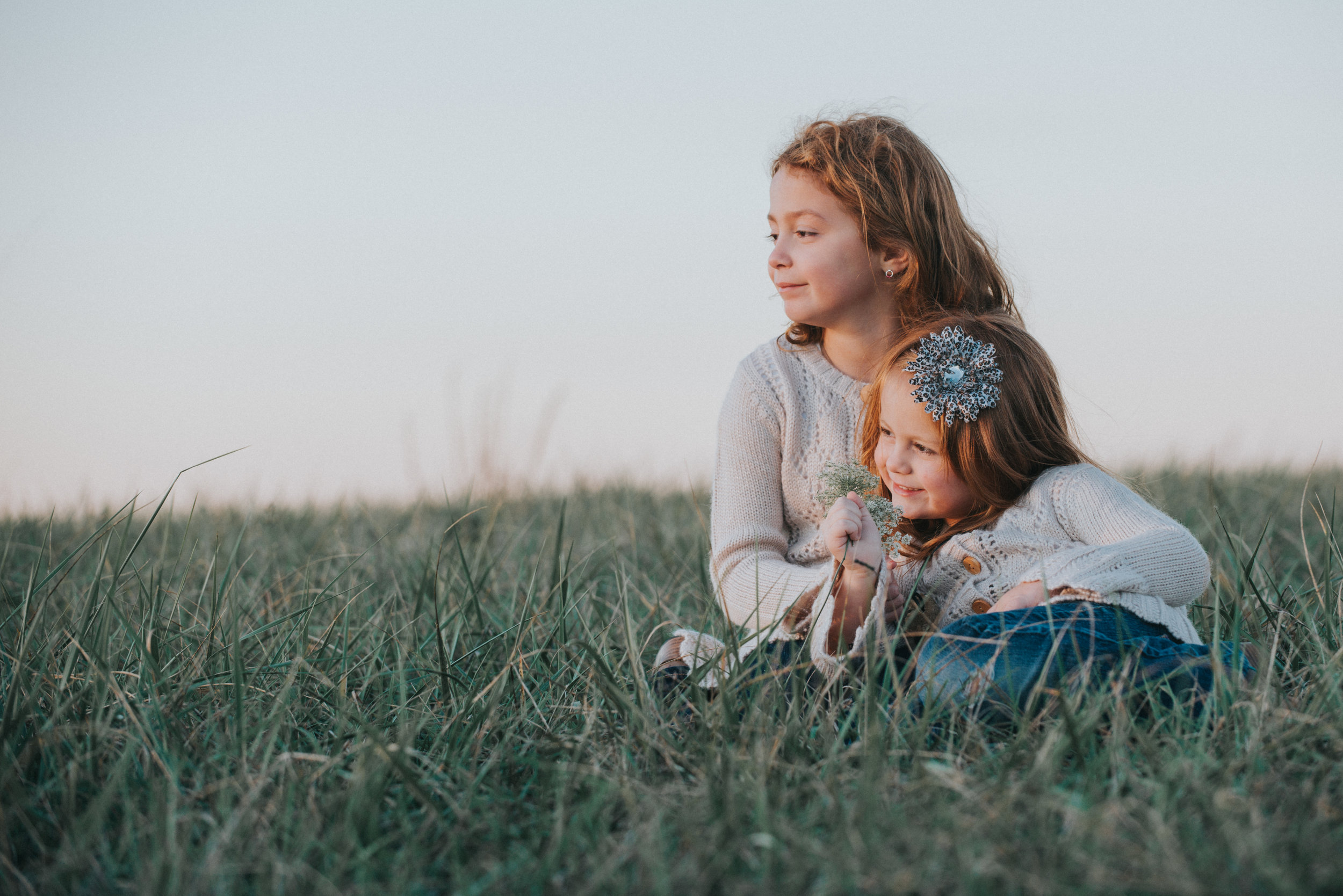 two little girls in a mountain meadow