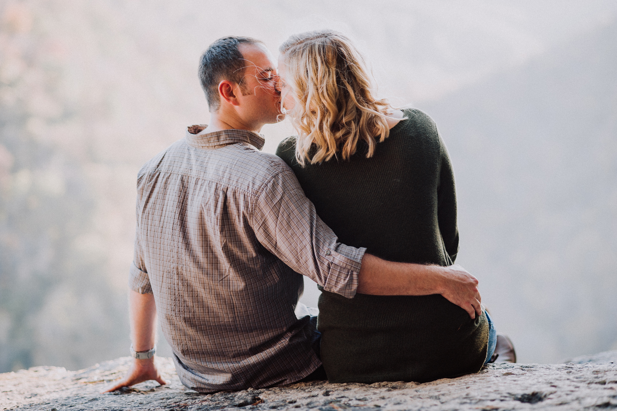 Couple shares a quiet moment at mountain top overlook