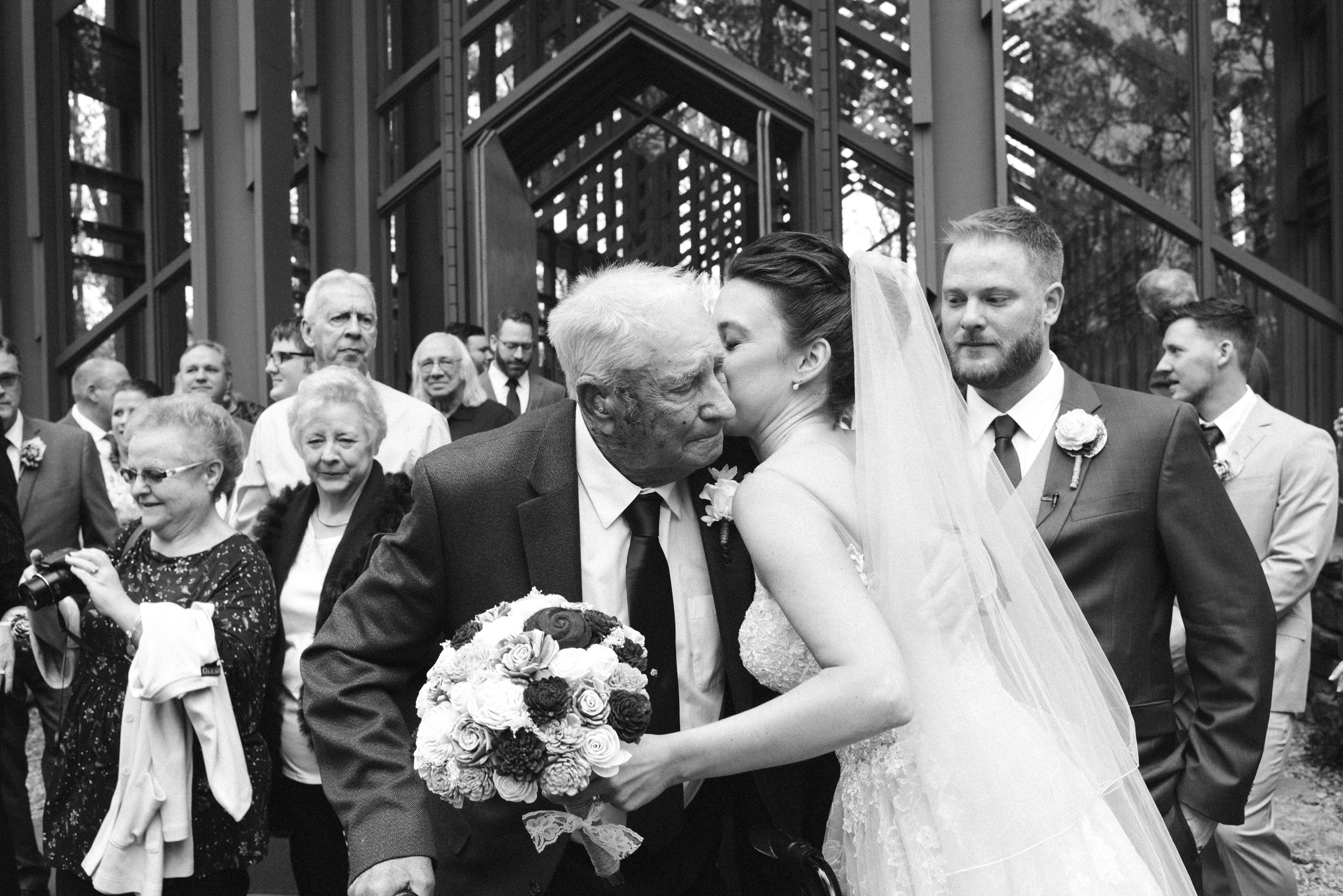 Bride kissing Grandfather